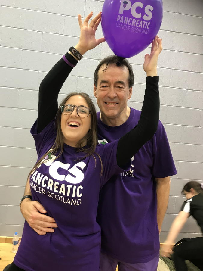 Two of our PCS members wearing our distinctive purple shirts supporting the PanCan Cause